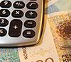 Kalkulator og pengesedler - gjeldsrådgiving - Advokat Vidar Sinding AS